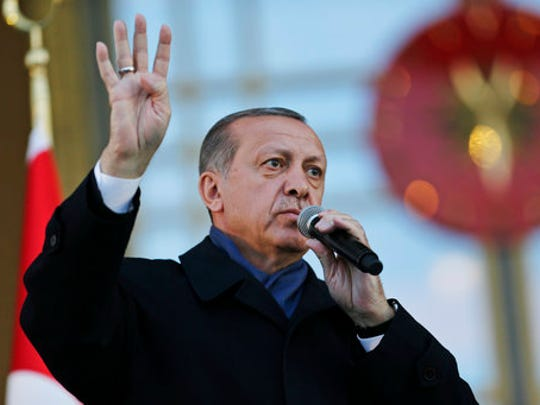 Turkey's President Recep Tayyip Erdogan, delivers a speech during a rally of supporters a day after the referendum, outside the Presidential Palace, in Ankara, Turkey, Monday, April 17, 2017. Turkey's main opposition party urged the country's electoral board Monday to cancel the results of a landmark referendum that granted sweeping new powers to Erdogan, citing what it called substantial voting irregularities.