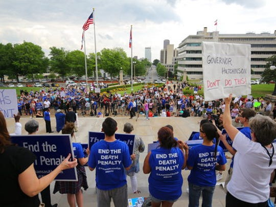 People gather at a rally opposing the state's upcoming executions, on the front steps of Arkansas' Capitol, Friday, April 14, 2017, in Little Rock, Ark.