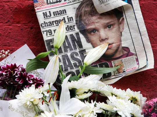 FILE - This May 28, 2012, file photo shows a newspaper with a photograph of Etan Patz at a makeshift memorial in the SoHo neighborhood of New York where Patz lived before his disappearance on May 25, 1979. Pedro Hernandez, the man convicted of killing Patz, is set to learn his punishment in one of America's most notorious missing-child cases on Tuesday, April 18, 2017.