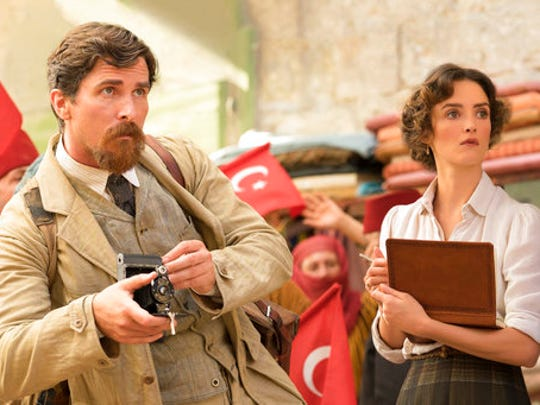 "This image released by Open Road Films shows Charlotte Le Bon, right, and Christian Bale in a scene from ""The Promise."""
