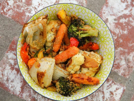 This April 2017 photo shows hummus-crusted roasted vegetables in Coronado, Calif. This dish is from a recipe by Melissa d'Arabian.