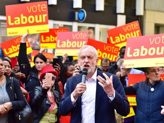 Labour party leader, Jeremy Corbyn, centre, delivers a speech to Labour activists at a bank in Croydon, south London, Wednesday April 19, 2017. Lawmakers voted Wednesday by a resounding 522 to 13 to back Prime Minister May's call for an early election, on June 8, easily surpassing the two-thirds majority in the 650-seat House of Commons needed to trigger an early vote.