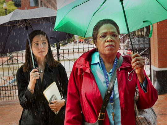 """This image released by HBO shows Rose Byrne, left, and Oprah Winfrey in a scene from HBO film """"The Immortal Life of Henrietta Lacks,""""  premiering Saturday at 8 p.m. EDT."""