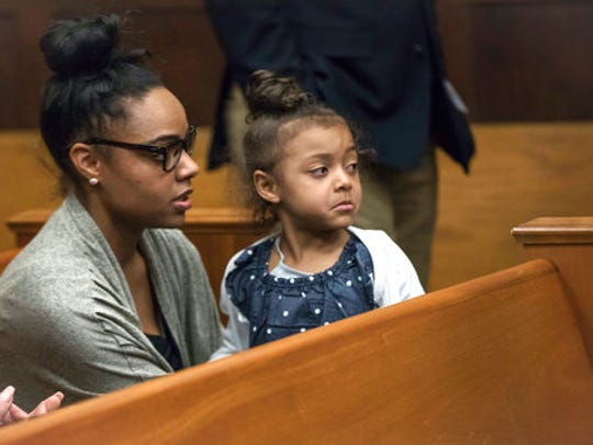 FILE - In this Wednesday, April 12, 2017, file photo, Shayanna Jenkins Hernandez, fiancee of former New England Patriots tight end Aaron Hernandez, sits in the courtroom with the couple's daughter during jury deliberations in Hernandez's double-murder trial at Suffolk Superior Court in Boston. Hernandez was acquitted of those crimes on Friday, but hanged himself in his prison early Wednesday, April 19, 2017, where he was serving a life sentence in the 2013 killing of semi-professional football player Odin Lloyd.