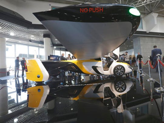 AeroMobil display their latest prototype of a flying car, in Monaco, Thursday, April 20, 2017. The light frame plane whose wings can fold back, like an insect is boosted by a rear propeller. The company says it is planning to accept first preorders for the vehicle as soon as later this year.