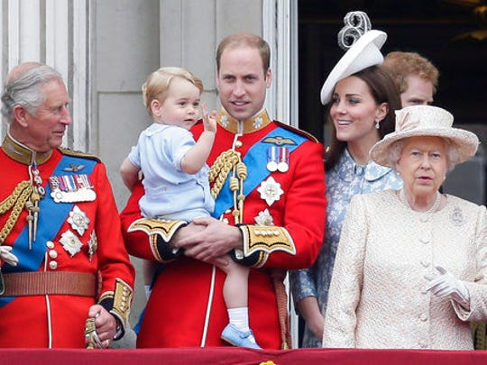 FILE - In this Saturday, June 13, 2015 file photo, Britain's Prince William holds his son Prince George, with Queen Elizabeth II, right, Kate, Duchess of Cambridge and the Prince of Wales during the Trooping The Colour parade at Buckingham Palace, in London. Britain's Queen Elizabeth celebrates her 91st birthday on Friday, April 21, 2017.