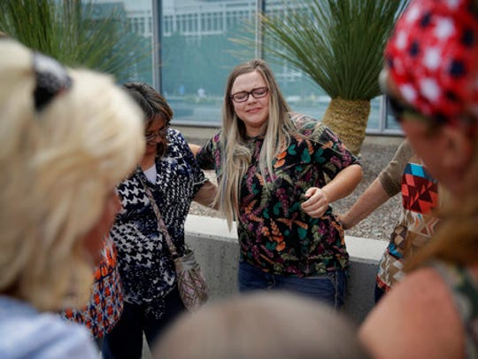 Bailey Logue, center, daughter of Cliven Bundy, embraces others after a partial verdict outside of the federal courthouse, Monday, April 24, 2017, in Las Vegas. A jury found two men guilty of federal charges Monday in an armed standoff that stopped federal agents from rounding up cattle near Cliven Bundy's Nevada ranch in 2014. Jurors said they were deadlocked on charges against four other men, and the judge told them to keep deliberating.