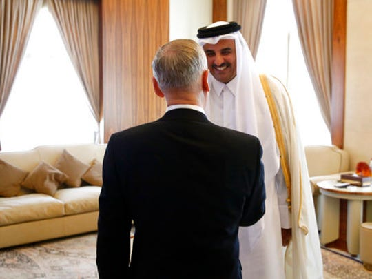 Qatar's Emir Sheikh Tamim Bin Hamad Al-Thani, right, greets U.S. Defense Secretary Jim Mattis at his residence, the Sea Palace, in Doha, Qatar, Saturday, April 22, 2017.