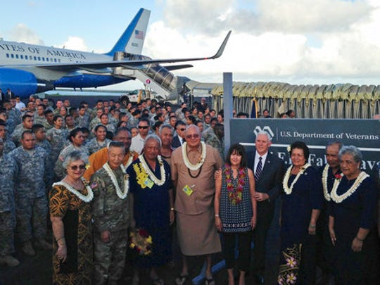 Vice President Mike Pence stands with his wife Karen as they pose for a photo with officials and U.S. service members during a refueling stop in Pago Pago, American Samoa, Monday, April 24, 2017. Pence stopped in American Samoa after leaving Australia en route to Hawaii.
