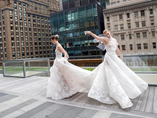 In this Friday, April 21, 2017 photo, the Monique Lhuillier bridal collection is modeled during bridal fashion week in New York.