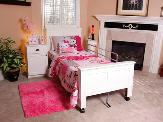 """This photo provided by Greg Verlander of TenderCare Beds shows a headboard and footboard designed to fit a hospital bed and outfitted with child-friendly """"Hello Kitty"""" bedding. He started the company as a way to bring more normalcy to people who require a hospital bed for sleeping."""