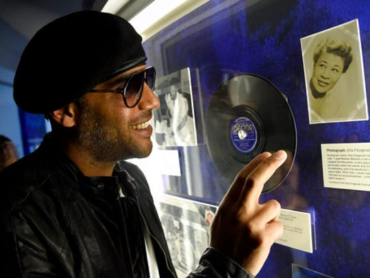 """Miles Mosley speaks during an interview at a sneak preview of """"Ella at 100: Celebrating the Artistry of Ella Fitzgerald"""" at The Grammy Museum at L.A. Live on Monday, April 24, 2017, in Los Angeles."""