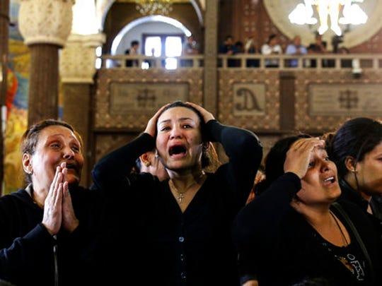 FILE - In this April 10, 2017 file photo, women cry during the funeral for those killed in a Palm Sunday church attack in Alexandria Egypt, at the Mar Amina Church. Egypt is embroiled in a blistering political feud over who speaks for Islam and how to bring reforms to counter Islamic militancy. At the center of it is Al-Azhar, one of the top institutions of clerics in the Muslim world and considered the bastion of moderate Islam. Critics, including Egypt's pro-government, say it is too tied down in old ways and failing to modernize its teachings, fueling extremism.