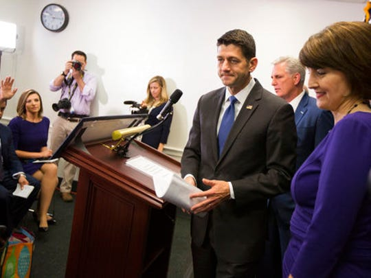 House Speaker Paul Ryan of Wis., accompanied by House Majority Leader Kevin McCarthy of Calif., center, and Rep. Cathy McMorris Rodgers, R-Wash., leaves a news conference after a GOP caucus meeting on Capitol Hill in Washington, Wednesday, April 26, 2017.