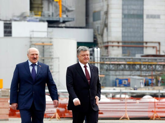 Ukrainian President Petro Poroshenko, right, and Belarus President Alexander Lukashenko visit the Chernobyl nuclear power plant in Chernobyl, Ukraine, Wednesday, April 26, 2017. April 26 marks the 31st anniversary of the Chernobyl nuclear disaster. A reactor at the Chernobyl nuclear power plant exploded on April 26, 1986, leading to an explosion and the subsequent fire spewed a radioactive plume over much of northern Europe.