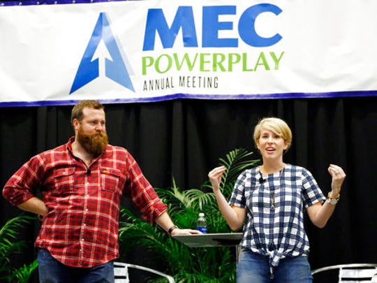 "Ben Napier, left, listens to his wife Erin recall how the two landed the HGTV home renovation series, ""Home Town,"" based in their hometown of Laurel, Miss., at the Mississippi Economic Council, the state Chamber of Commerce Thursday, April 27, 2017, in Jackson, Miss. The couple encouraged small businesses to invest in their communities in order to make a positive impact."