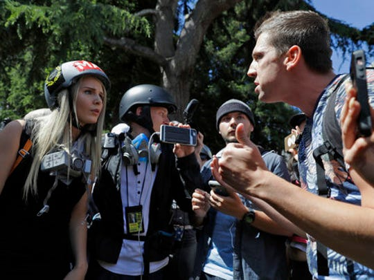 Demonstrators sharing opposing views argue during a rally April 27 in Berkeley, Calif. Demonstrators gathered near the University of California, Berkeley campus amid a strong police presence and rallied to show support for free speech and condemn the views of Ann Coulter and her supporters.