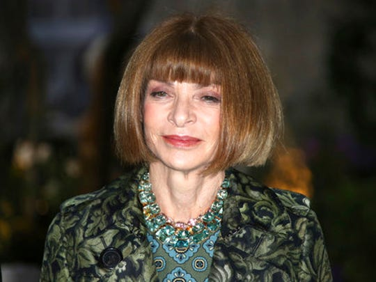 FILE - In this Sept. 19, 2016, file photo, Vogue editor Anna Wintour poses for photographers upon arrival at the Burberry Spring/Summer 2017 fashion show at London Fashion Week in London. Wintour is teaming up with Gwyneth Paltrow to take the actress' Goop website to print, magazine publisher Conde Nast announced on April 28, 2017.