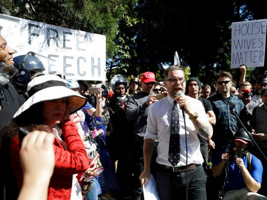 Gavin McInnes speaks at a rally for free speech Thursday, April 27, 2017, in Berkeley, Calif. Demonstrators gathered near the University of California, Berkeley campus amid a strong police presence and rallied to show support for free speech and condemn the views of Ann Coulter and her supporters.