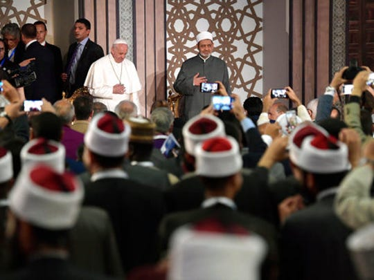 Pope Francis is flanked by Sheikh Ahmed el-Tayeb, Al-Azhar's grand imam, at Cairo's Al Azhar university, Friday, April 28, 2017. Francis is in Egypt for a two-day trip aimed at presenting a united Christian-Muslim front that repudiates violence committed in God's name.