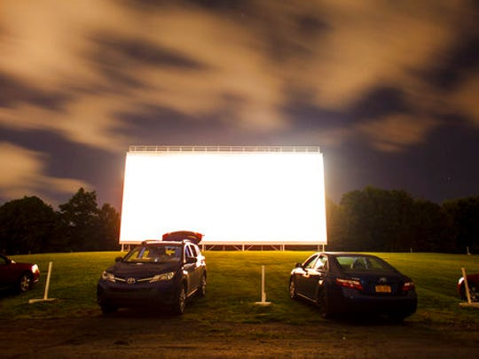 "In this Aug. 20, 2016 photo, cars are lined up as customers watch the film ""Kubo and the Two Strings"" at the Circle Drive-In Theatre in Scranton, Penn."