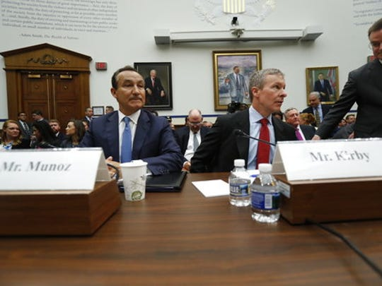 United Airlines CEO Oscar Munoz, left, and United Airlines President Scott Kirby, prepare to testify on Capitol Hill in Washington, Tuesday, May 2, 2017, to testify before a House Transportation Committee oversight hearing.