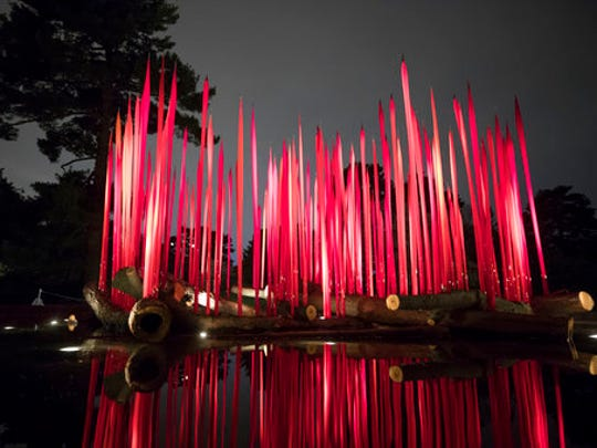 """This April 13, 2017 photo provided by the New York Botanical Garden shows Red Reeds on Logs which is part of the Chihuly exhibit at the New York Botanical Garden in New York. The show, titled simply """"Chihuly,"""" reveals the evolution of Dale Chihuly's work from 1980 to the present."""
