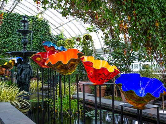 """This April 15, 2017 photo provided by the New York Botanical Garden shows Macchia Forest which is part of the Chihuly exhibit at the New York Botanical Garden in New York. The show, titled simply """"Chihuly,"""" reveals the evolution of Dale Chihuly's work from 1980 to the present."""
