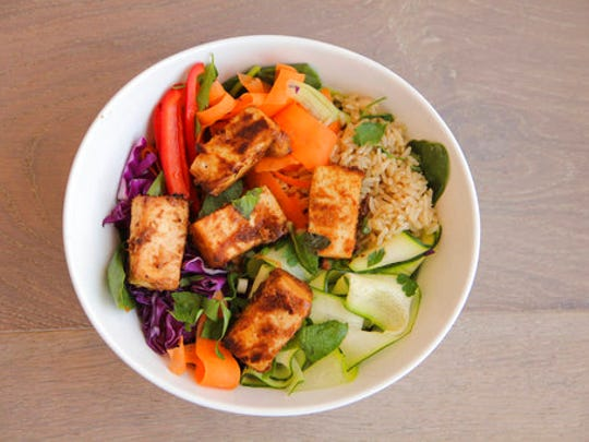 This April 29, 2017 photo shows a Thai peanut veggie and tofu bowl in Coronado, Calif. This dish is from a recipe by Melissa d'Arabian.