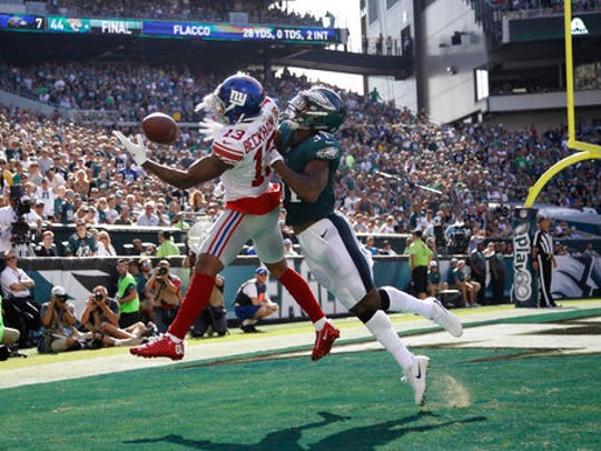 New York Giants' Odell Beckham, left, catches a touchdown