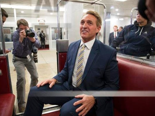 Sen. Jeff Flake, R-Ariz., talks to reporters just after a blistering speech on the Senate floor aimed at President Donald Trump, at the Capitol in Washington on Jan. 17, 2018.