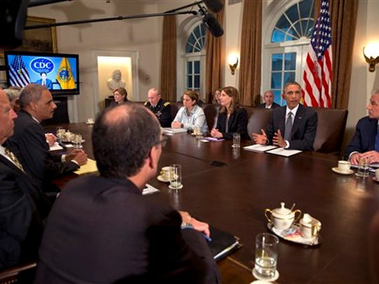 President Barack Obama, second from right, next to