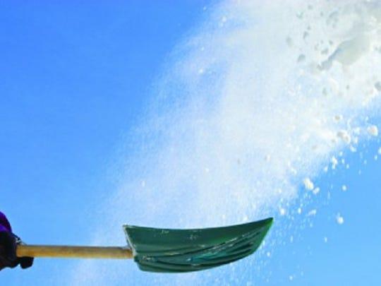 A person shoveling