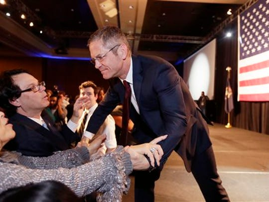 Michigan Democratic gubernatorial candidate Mark Schauer greets supporters after giving his concession speech at an election night rally in Detroit, Tuesday, Nov. 4, 2014. Republican Gov. Rick Snyder won a second term defeating Schauer after a closely watched race in which the Republican touted an economic and fiscal turnaround and promised to keep Michigan on the right path. (AP Photo/Carlos Osorio)