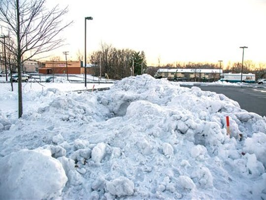 The snowbank in which cousins Jason Rivera and Elijah Martinez built their snow fort sits at the corner of a parking lot in Newburg, N.Y., Friday, Nov. 28, 2014. The boys were trapped for seven hours after a plow truck pushed snow on top of their fort but a local police officer saw footprints and a partially buried shovel so he started digging. Rivera and Martinez were eventually freed from five feet of plowed snow.
