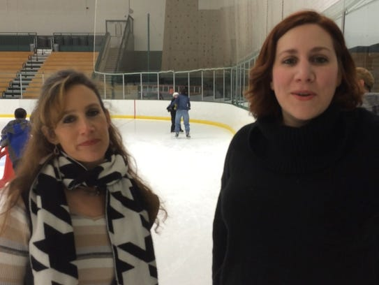 Carrie Hutton, left, communications director at the