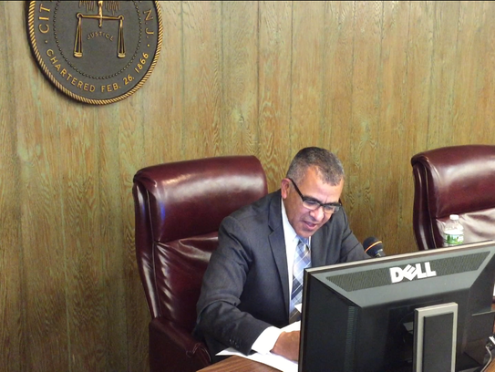 Millville Mayor Michael Santiago signs off on documents