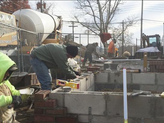 A concrete planter (forefront) under construction on