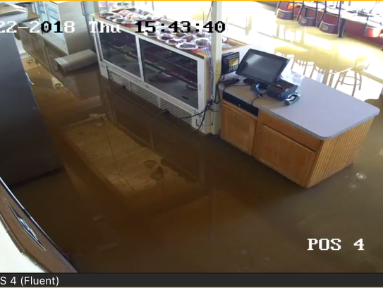 Bake N' Cakes security footage shows about six inches