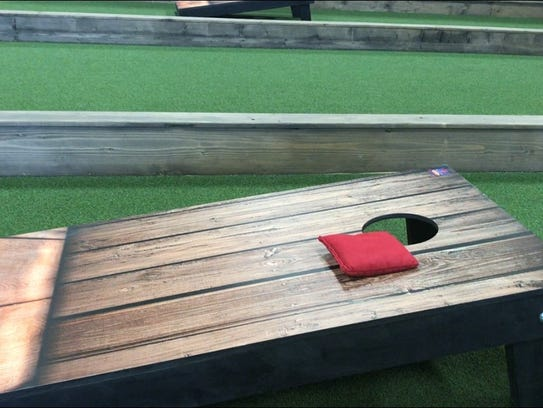 Backyard guests can rent a lane to play cornhole, bocce