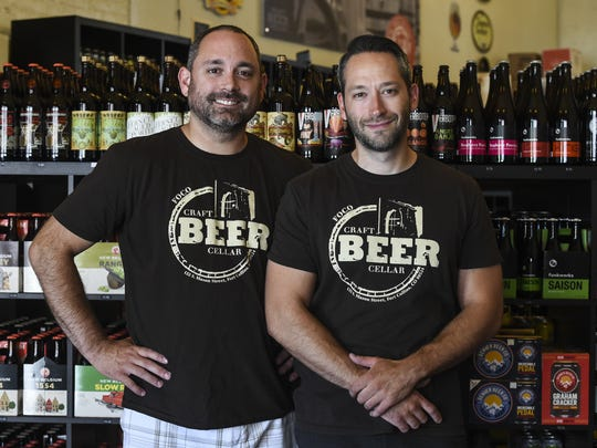Owners Justin Wright, left, and Chris Lazzery pose for a portrait at the Craft Beer Cellar in Fort Collins in this 2015 file photo.