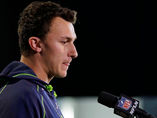 Texas A&M quarterback Johnny Manziel answers a question during a news conference at the NFL football scouting combine in Indianapolis, Friday, Feb. 21, 2014.