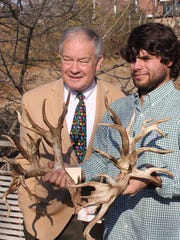 Tennessee Wildlife Resources Agency executive director Ed Carter, left, got to see the antlers from the new state record and possible world record deer killed in November by Stephen Tucker, who is holding the rack.