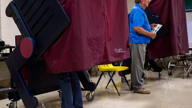 Voters cast their ballots at Lafayette Middle School in Lafayette, La., Saturday, Oct. 24, 2015.