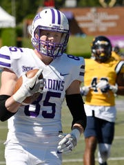Furman's Andy Schumpert (85) hits the end zone against