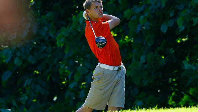 Mishicot's Austin Schnell tees off onto 11th hole during WIAA Division 3 state boys golf tournament Monday, June 5, 2017, at University Ridge Golf Course in Madison, Wis.