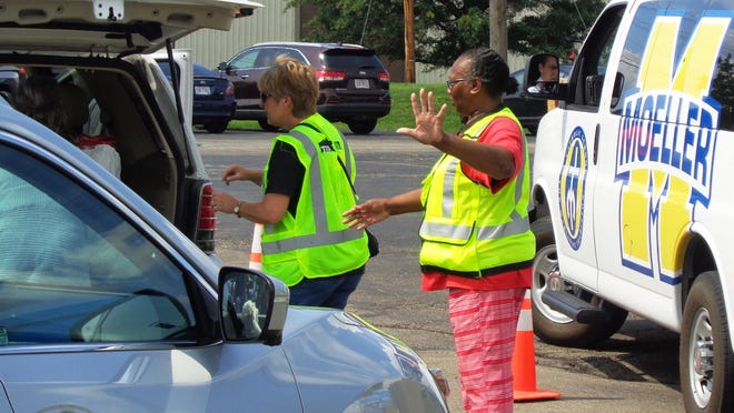 Deborah Bryant, of Woodlawn, is one of thousands of local volunteers responding to Hurricane Harvey relief efforts at Matthew 25: Ministries in Blue Ash, Ohio, on Sept. 5, 2017.