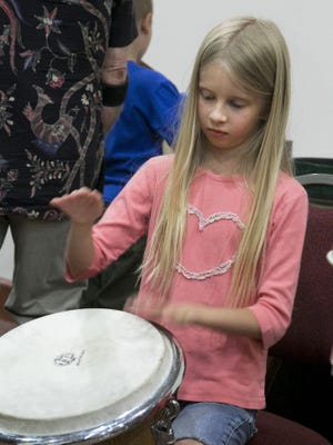 Kids are given the chance to try out all kinds of musical instruments before the show in the Heritage Center Theater in Cedar City Monday, kicking off the week-long Groovefest.