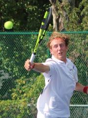 Seaholm senior Nick Adams manages to get his raquet