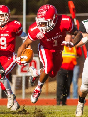 Paulsboro kick returner Dehron Holloway (1) returns the opening kick against West Deptford at Paulsboro High School on Saturday, November 25.